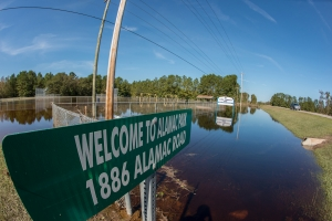 Alamance Community Park, in Robeson County, near Lumberton, NC, remained inundated with flood waters on Oct. 16, 2016. Floodwater from Hurricane Matthew came to the bottom edge of the park signs when the storm first hit. USDA Photo by Lance Cheung.